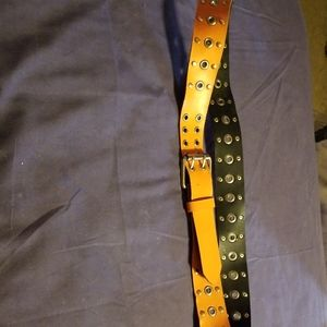 Orange leather belt with silver grommets and flat